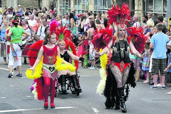 This Is Wiltshire: These sambistas, in all their feathery finery,  really got into the swing of the carnival