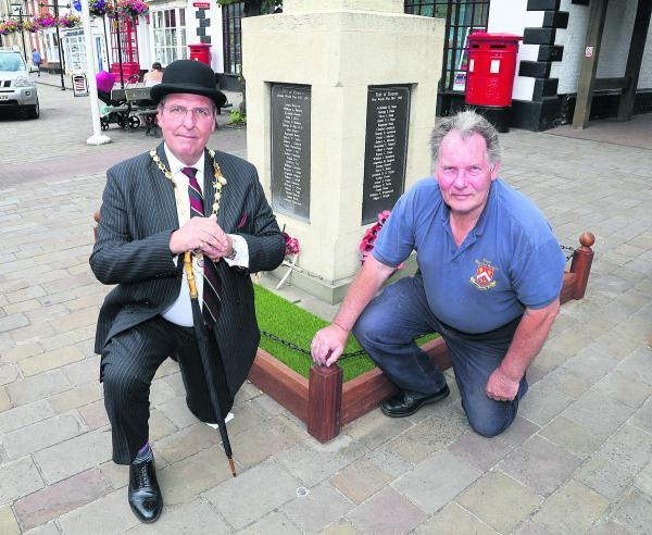 This Is Wiltshire: Deputy mayor Ian Ferries and Coun Chris Wannell at the memorial