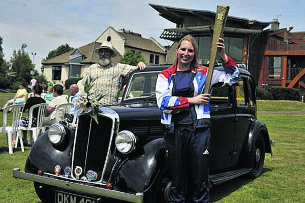 This Is Wiltshire: Paralympian Stephanie Millward arrives to open the Dorothy House Summer Fete, chauffered by Steve Knight;