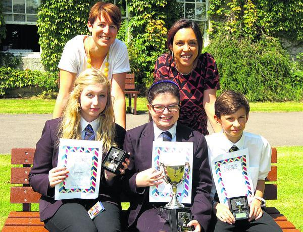 This Is Wiltshire: Devizes School poetry winners Sophie Wilson, left, Lucy Maher and Ben Brown with teachers Helen Carpenter, left and Susanna Mountcastle