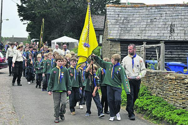 This Is Wiltshire: Broughton Gifford and Holt Scouts make their way through the village on Sunday