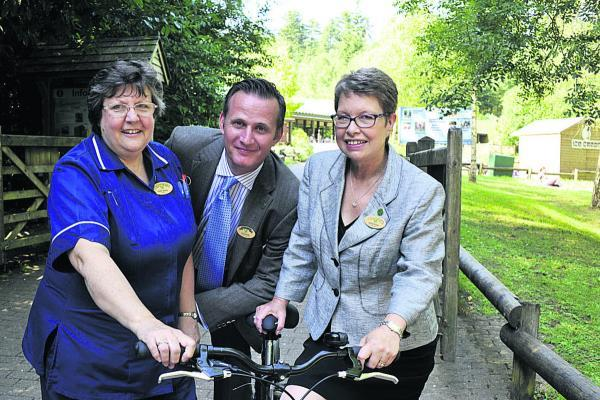 This Is Wiltshire: Longleat general manager Andy De'Ath with long-servers Helen Warley and Jackie Rosier