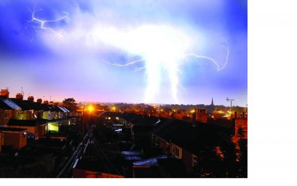 This Is Wiltshire: An electrical storm breaks spectacularly over the town centre
