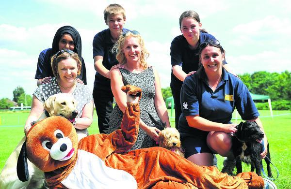 This Is Wiltshire: Pupils Imrana, Jack and Sophie at the back, with staff Sandra Muir, Esther Newman and Katherine O'Rourke. Rochelle is inside the costume