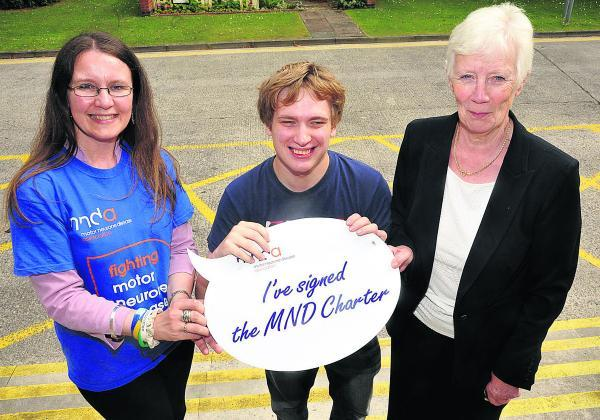 The Motor Neurone Association is celebrating Swindon Council's adoption of a new charter for MND rights. From left, Heather Smith, the campaigns contact for North Wilts MND, campaign volunteer Sam James and Coun Ray Ballman