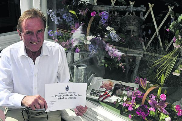 This Is Wiltshire: Michael Clarke with his prize-winning window display. Picture by Glenn Phillips (49602)