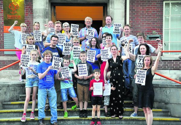 This Is Wiltshire: Coun Nadine Watts front, right, with protesters at the Civic Offices