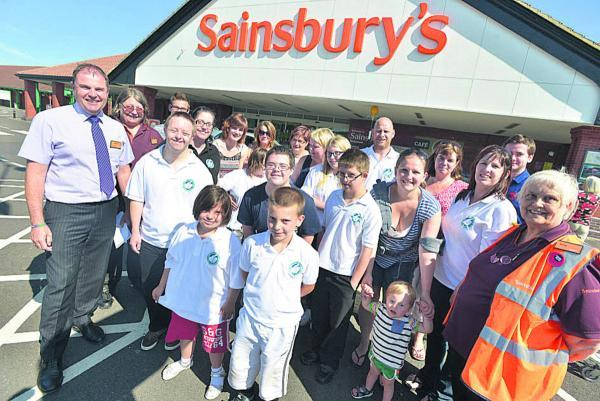 This Is Wiltshire: Members of Swindon Down's Syndrome Group and Sainsbury's Bridgmead staff