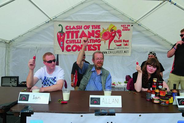 This Is Wiltshire: A chilli-eating contest, part of a chilli festival at Wharf Green. Contestants include from left, Ian Tracey, Allan Catlin and Tamsin Findlay.