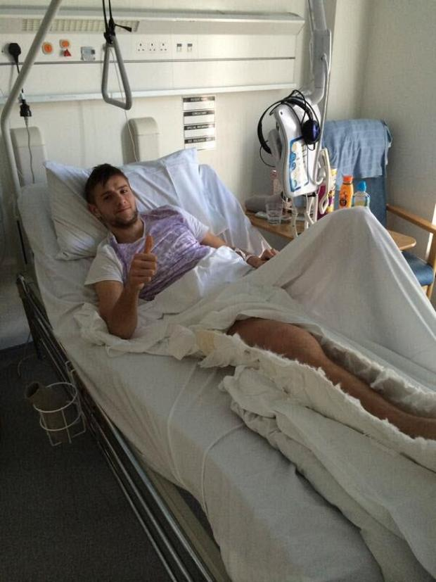 This Is Wiltshire: Rob Dean in hospital just after receiving his horror injury against Hungerford last season