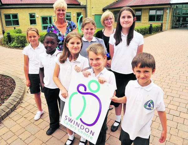 This Is Wiltshire: Teachers Jill Edwards left, and and Fiona Pungi, right, with pupils