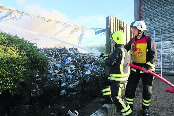 This Is Wiltshire: Firefighters trying to keep yesterday evening's blaze at bay