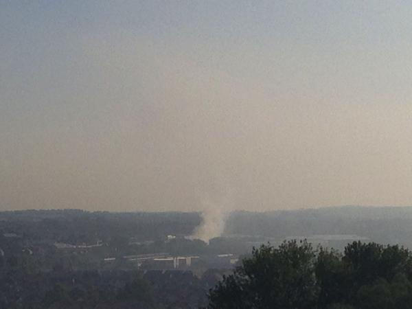 This Is Wiltshire: Smoke still billowing across the Swindon skyline this morning