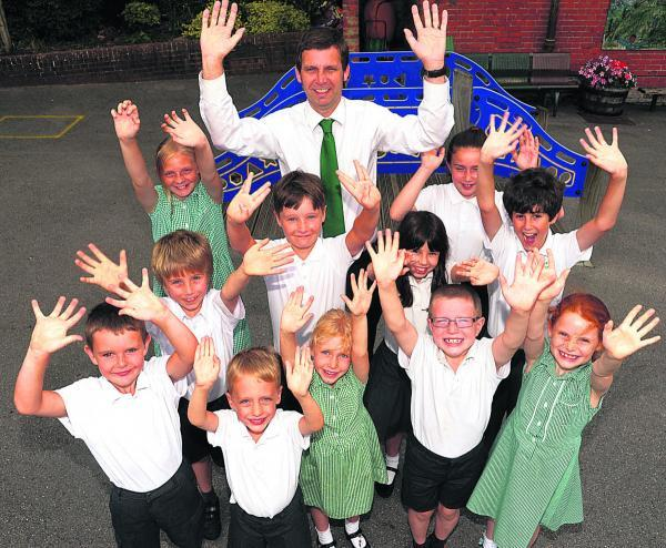 This Is Wiltshire: Headteacher Chris Cannings celebrates with Ivy Lane pupils. Picture by Vicky Scipio