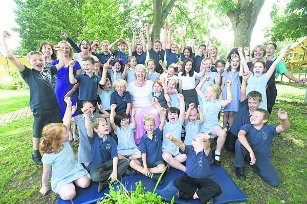 This Is Wiltshire: A rousing send-off for Debbie Short, centre, by pupils and staff at Seagry School. Picture by Diane Vose