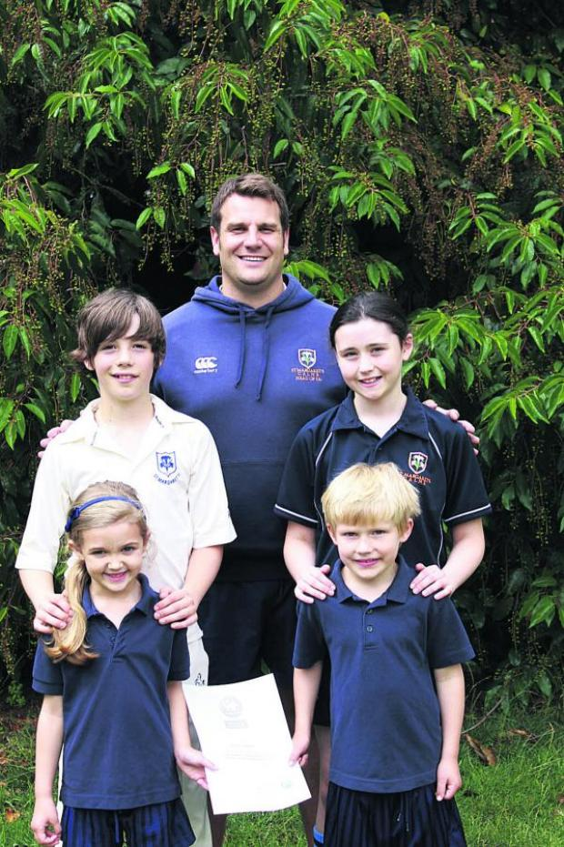 This Is Wiltshire: Head of sport Dan Dury with Artie and Maisie from Year 6 and Missy and Charlie from Reception