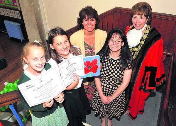 This Is Wiltshire: Highly commended pupil Christen Watts, left, and winner Arwen Crook with Caroline Spindlow, art leader Becky Ambrosini and mayor Marian Hannaford-Dobson(vs603) By vicky scipio