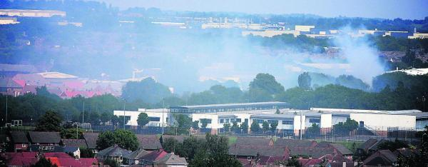 This Is Wiltshire: The smoke from the fire at Greenbridge is still hanging over the town