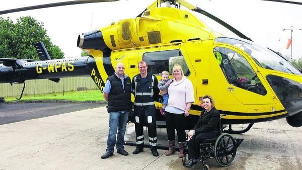 This Is Wiltshire: Phil Harding, Officer Kevin Reed, Kate Harding Alex Freestone and  Michelle Agostino, who are organising the North Swindon Festival and will be raising money for Wiltshire Air Ambulance