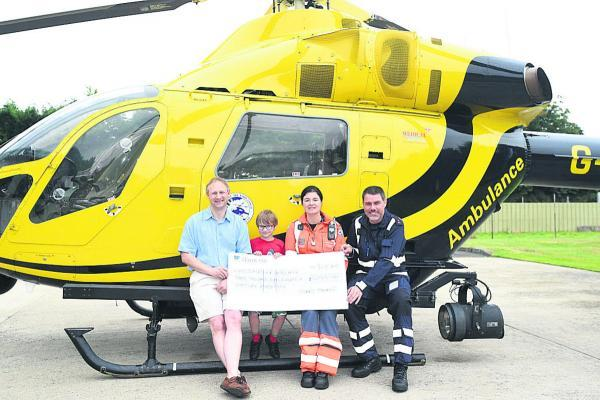 This Is Wiltshire: Stuart Foulstone and his son William with air ambulance paramedic Joanne Munday and PC Nigel Gilbert