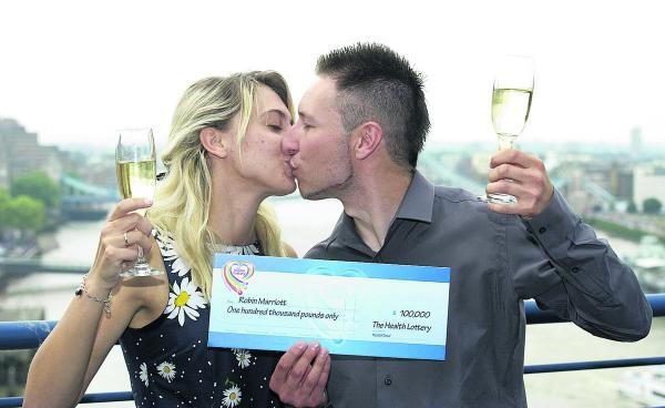 This Is Wiltshire: Robin Marriott and girlfriend Keana Marsh celebrate his big £100,000 Health Lottery win