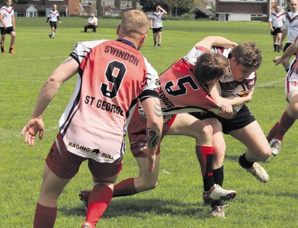 This Is Wiltshire: Gwyn Jenkins looks on as Declan Mann makes a tackle in St George's season opener against Somerset