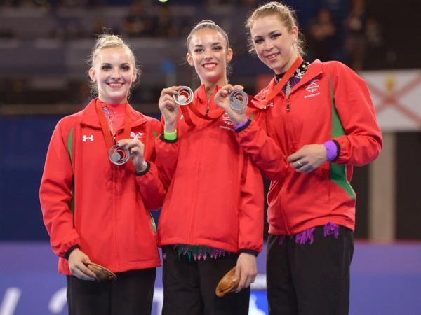 This Is Wiltshire: Laura Halford, centre, winning team bronze in the all-around
