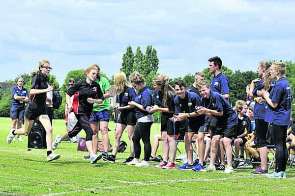 This Is Wiltshire: Sports Day at John of Gaunt School Trowbridge on Monday with pupils who are volunteer sports leaders helping to run the event