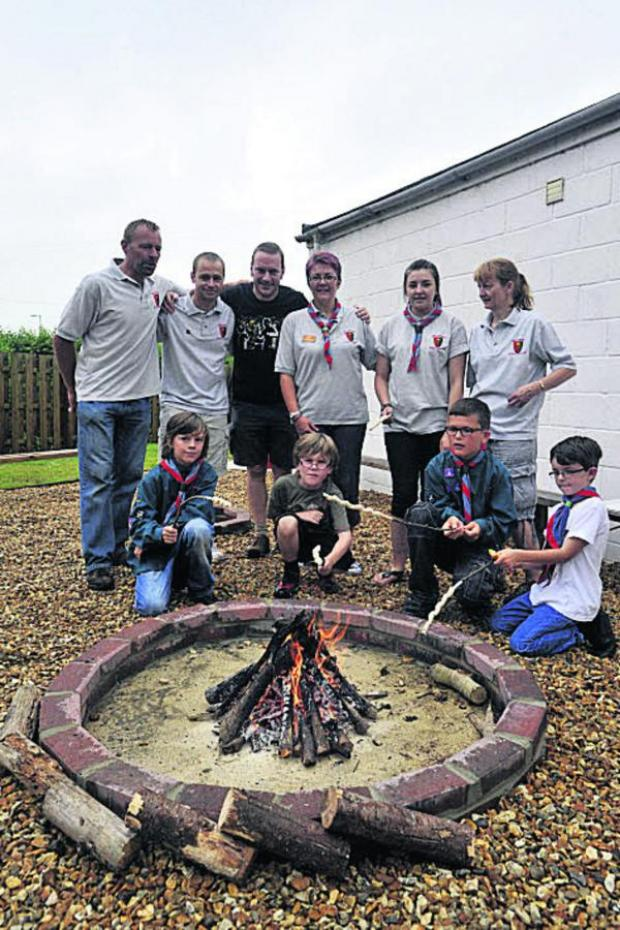 This Is Wiltshire: Melksham Scout Group members in the new campfire area at their Summer Fair