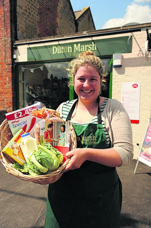 This Is Wiltshire: Ellie Whitehead at the Dilton Marsh Shop now reopened complete with Post Office