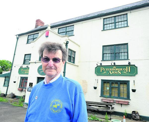 This Is Wiltshire: Chris Coyle, acting chairman of the Wilts and Berks Canal Trust, outside the Peterborough Arms last year