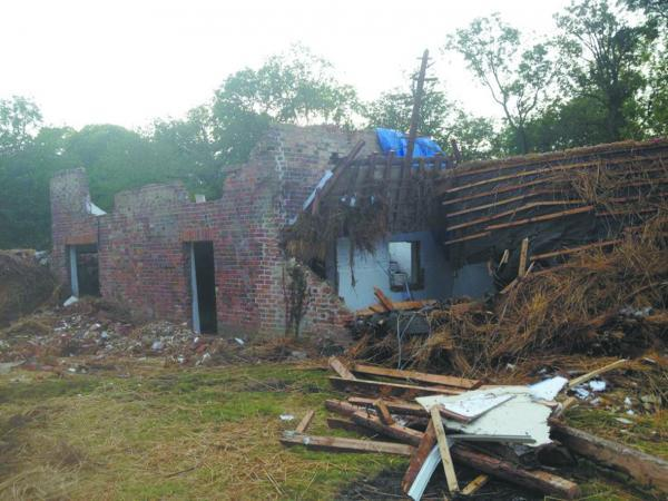 This Is Wiltshire: A picture taken on July 7 after demolition work at the cottage at Stokke Common
