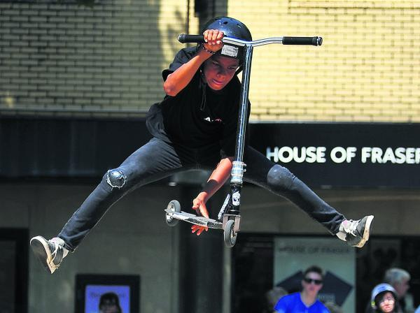 This Is Wiltshire: Youngsters get on their skates in the town center
