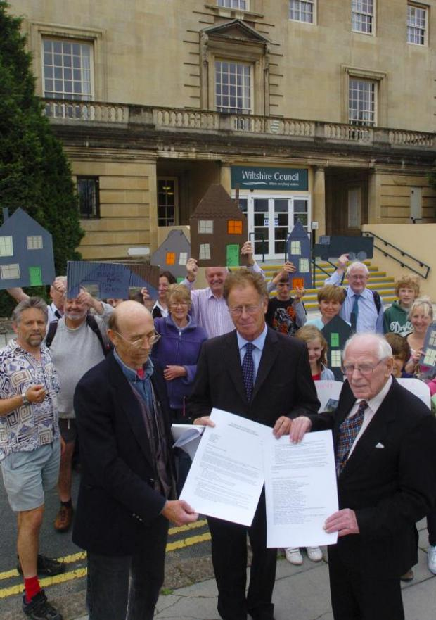 This Is Wiltshire: Patrick Kinnersly, front righ, of White Horse Alliance with George McDonic, (front right,  of the CPRE and supporters presenting a letter objecting to the Wiltshire Core Strategy plan to Cllr Toby Sturgis in 2011