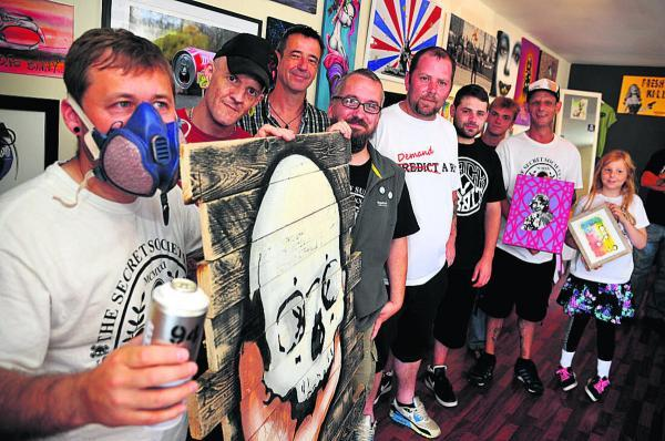 This Is Wiltshire: As part of the free art Friday programme street artists from across the country hosted an exhibition at the Jack Rabbit shop, Crombey Street. Left to right are Silent Bill, Bunny Boiler, Dice Sixty Seven, Hmm Bates, Rumple Stiltskin, Jamien Gurk, Angus Ar