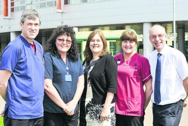 This Is Wiltshire: Members of the breast cancer team are, left to right, Dr Nick Ridley, director of  radiology, receptionist Pam Durston, breast cancer manager Suzie Ferrari, imaging assistant Anne Fullerton, and consultant breast surgeon Nathan Coombs