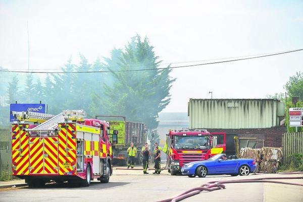 This Is Wiltshire: Fire engines at Averies Recyling yesterday, where the fire is still going and causing smoke