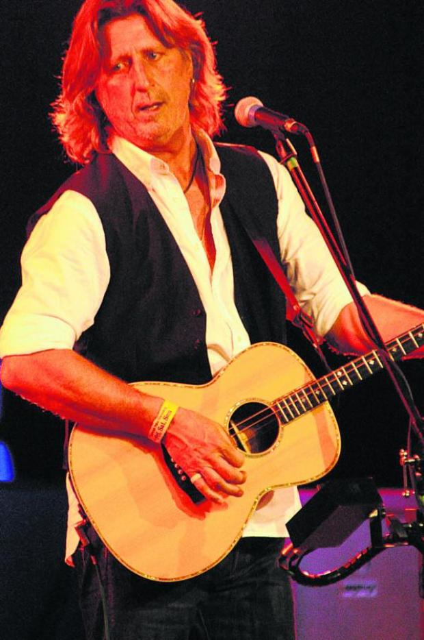 This Is Wiltshire: Patron Steve Knightley on the main stage the Village Pump Folk Festival on Friday. Picture by Trevor Porter