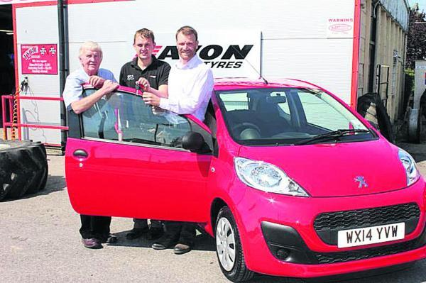 This Is Wiltshire: Colin and James Love hand the keys to a new Peugeot 107 to Simon Bridgford-Whittick