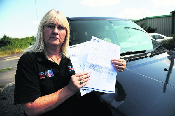 This Is Wiltshire: Gail Greatwood with her letters regarding her fine, despite her having had a valid parking ticket. Picture by Trevor Porter