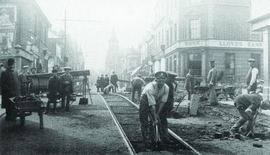 This Is Wiltshire: Soldiers drafted in to work on the Golden Lion bridge area in Swindon town centre. Some were recuperating from wounds, others were part of the Labour corps – men no longer fit for fighting but okay for manual labour