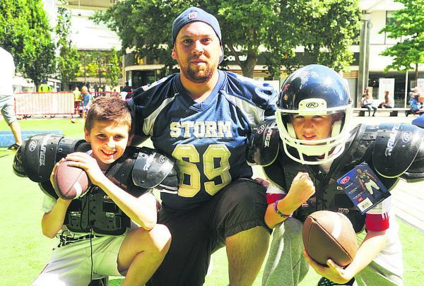 This Is Wiltshire: American Football being taught with Swindon Storm. Pictured, left to right, are Callum Haze, Andy Wilson and Cameron Haze