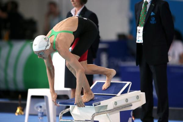 This Is Wiltshire: Jazz Carlin dives off the block on her way to winning the women's 800m final at Glasgow 2014 tonight