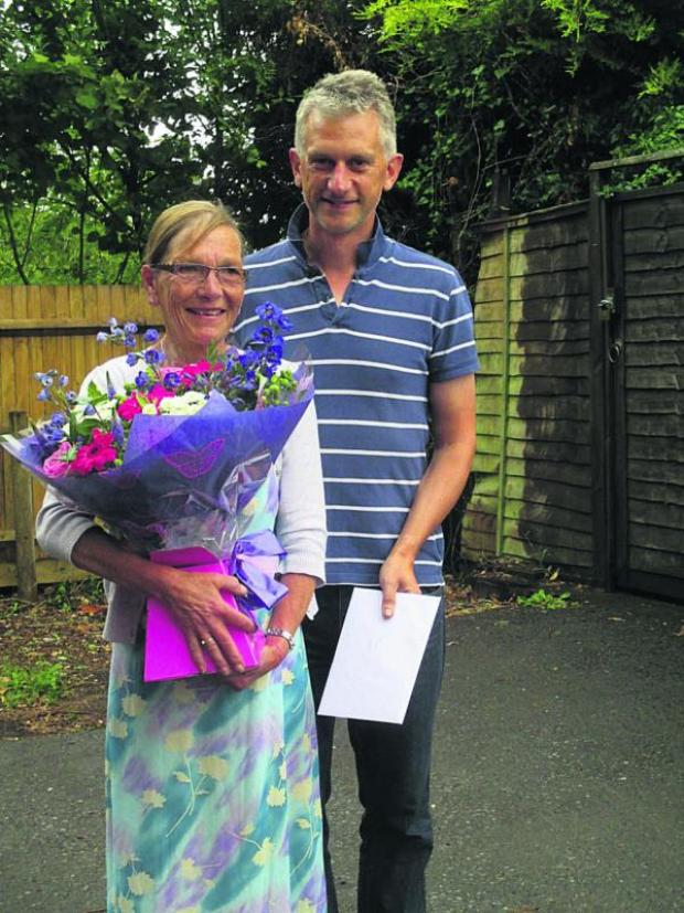 This Is Wiltshire: Sue Allsop, who is retiring from All Cannings community shop, with shop chairman Paul Oakley