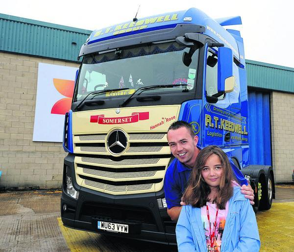 This Is Wiltshire: Hannah Rose Woodruffe in front of the truck with driver Scott Henson. Picture by Paul Morris