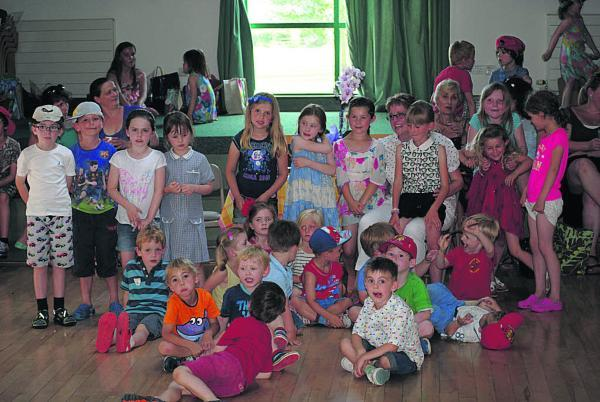 This Is Wiltshire: Karen Swannack, in white, is surrounded by children at