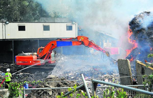 This Is Wiltshire: The ongoing fire at the Averies recycling site at Marshgate in Swindon. The blaze started on Monday, July 21 and there is no sign of it going out