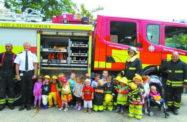 This Is Wiltshire: Youngsters all dressed up to meet firefighters during their visit at Devizes Fire Station