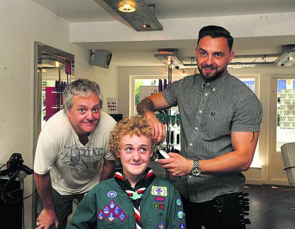 This Is Wiltshire: Andy Baugh, left, with son Daniel Scott, as Kadiem hair salon co-owner Mike Wesley gets to work