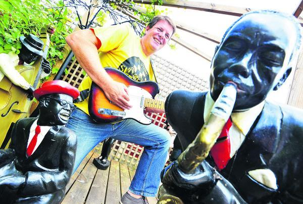 This Is Wiltshire: Dave Young on his guitar surrounded by old statues from The Vic